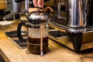 Pressing-on-a-french-press